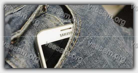 смартфон на улице в кармане