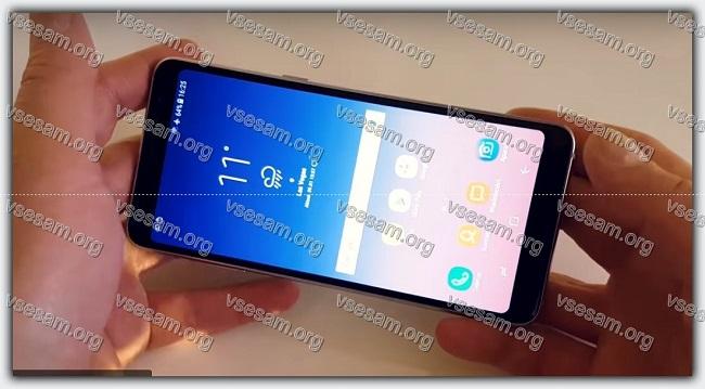 смартфон самсунг а8 плюс в руках пользователя