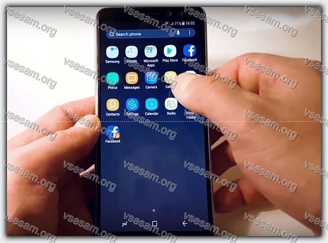 телефон самсунг галакси а8 в руках пользователя